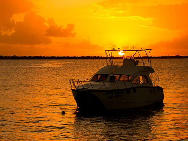 PADI Boat in Sunset - Travel